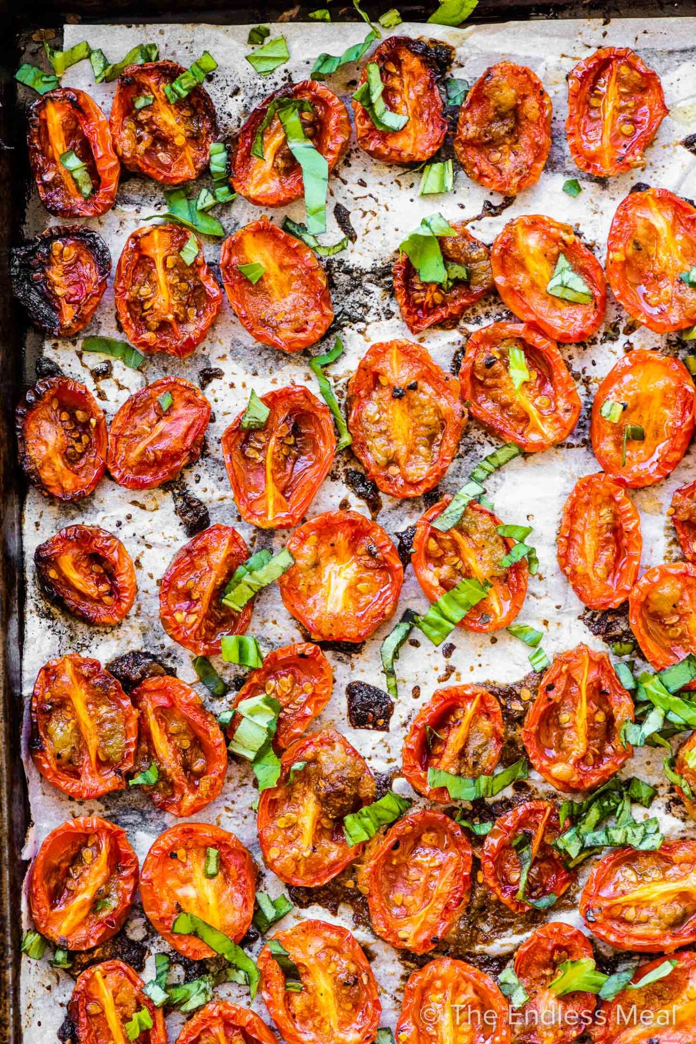 A close up of Roasted Cherry Tomatoes on a baking sheet.
