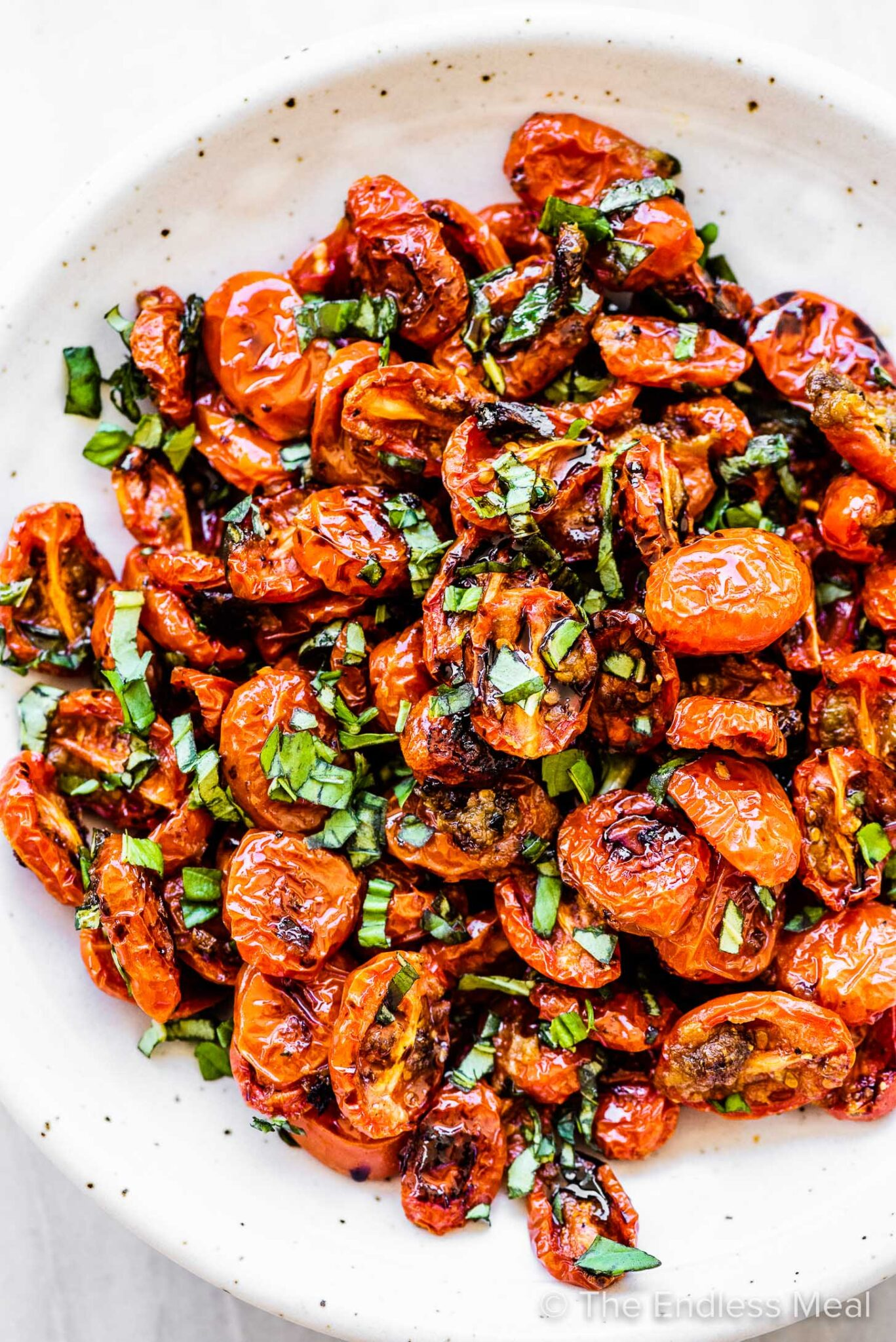 Roasted Cherry Tomatoes piled high in a white bowl.