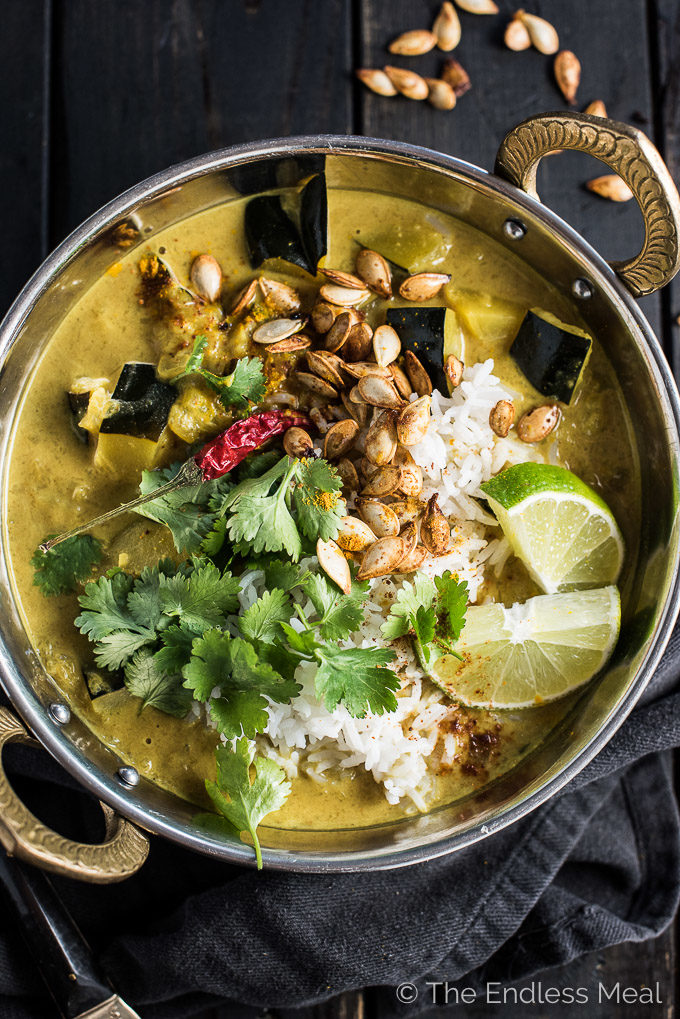 Looking down on a Indian-style bowl filled with acorn squash curry.