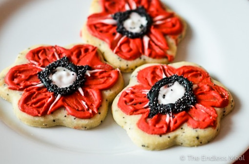Lemon sugar poppy cookies for Remembrance Day on a plate.
