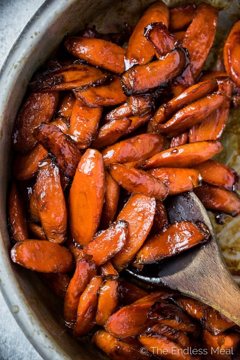 These easy to make Bourbon Maple Glazed Carrots are insanely delicious. They're lightly steamed then finished in a  bourbon and maple syrup glaze that has a tiny hint of spice. Even though they're a healthy holiday favorite, you'll want to keep making this recipe all year long.  | theendlessmeal.com