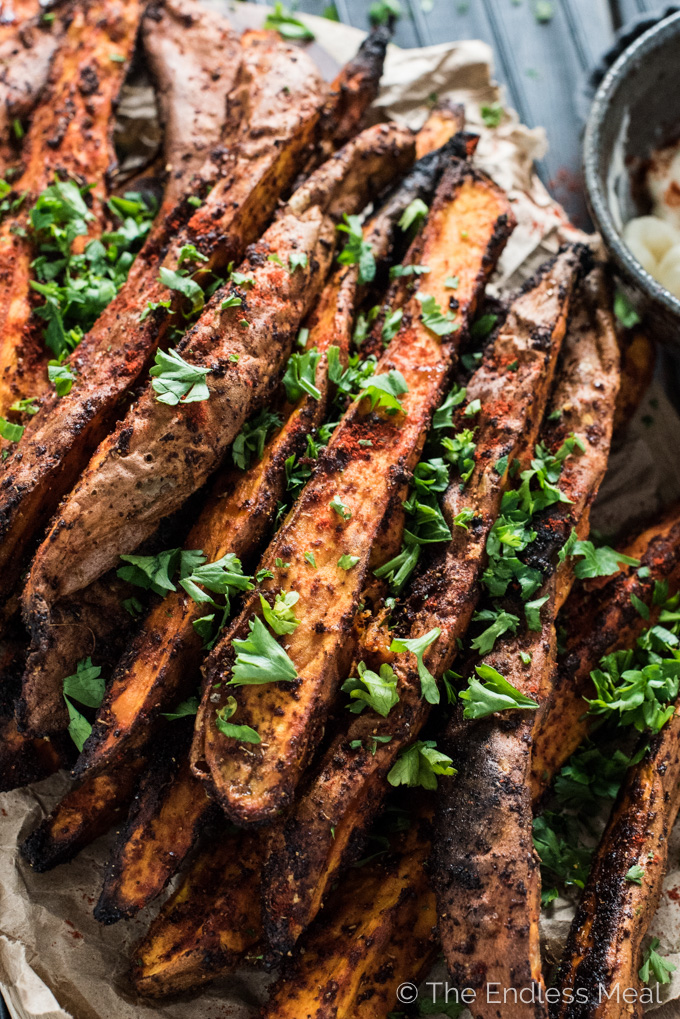 These easy to make Sweet and Spicy Yam Wedges are covered in smoked paprika and chili spices then baked till tender and delicious. They're simple side dish recipe everyone will love.   theendlessmeal.com