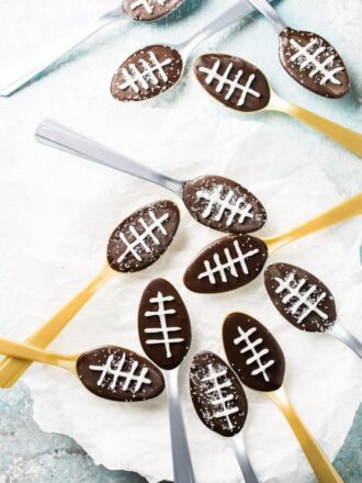 Chocolate Football Spoons are perfect for Super Bowl Sunday! They're super easy to make and make a playful addition to any game day table. Plus you can add lots of different flavors or make a boozy version for adult get togethers.  | theendlessmeal.com
