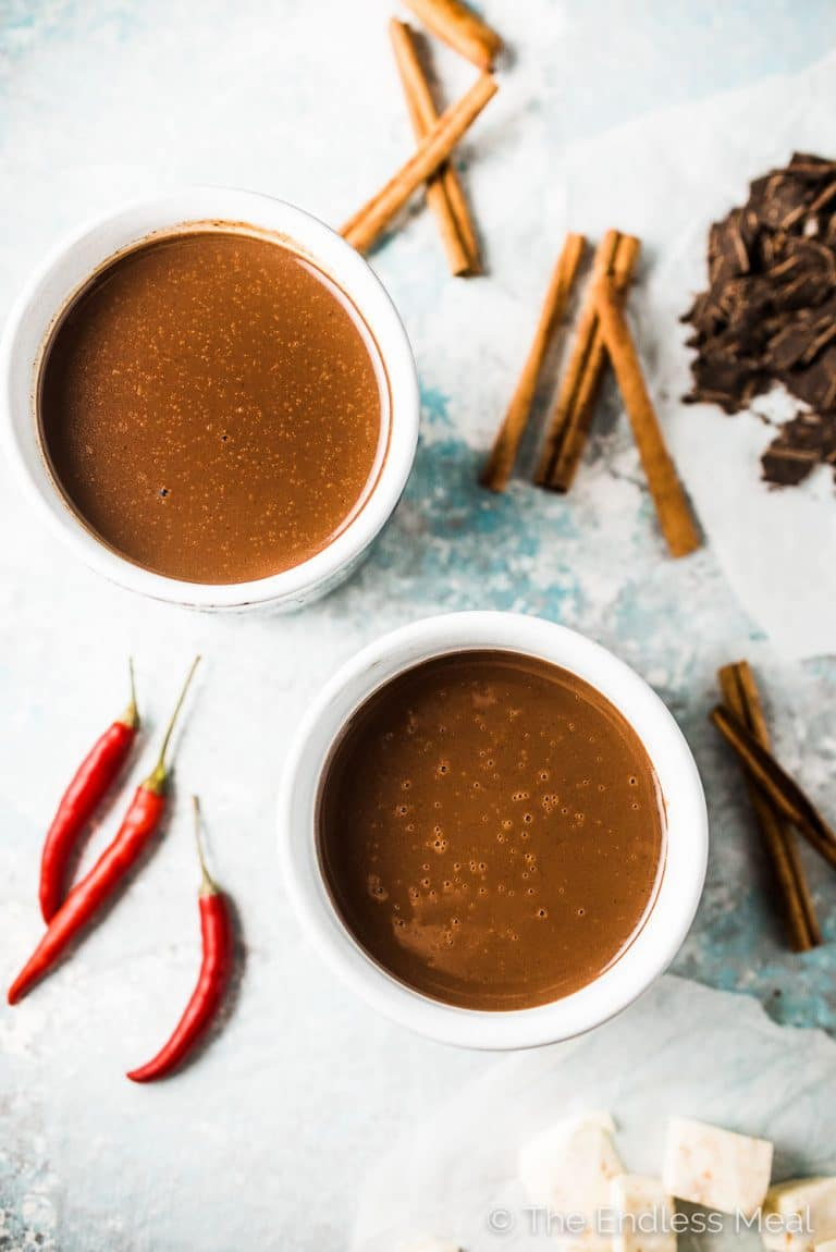 Want the best hot cocoa recipe ever? I thought you might! This spicy Aztec Hot Chocolate is my all-time favorite. It's made with real chocolate, spiced with cinnamon and vanilla, and has a little kick from a chili pepper. It's the best! | theendlessmeal.com |#hotchocolate #drinks #christmasdrinks #hotchocolaterecipes
