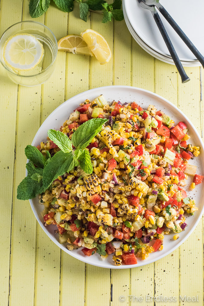 This Roasted Corn and Avocado Salad is an easy to make and incredibly delicious summer side dish that just so happens to be 100% vegan. You will LOVE it! | theendlessmeal.com
