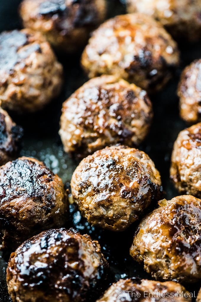 A closeup of well browned meatballs for the best spaghetti and meatballs recipe.