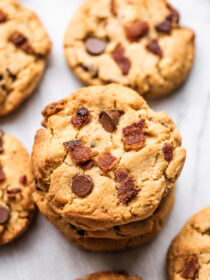A stack of peanut butter cookies with bacon.