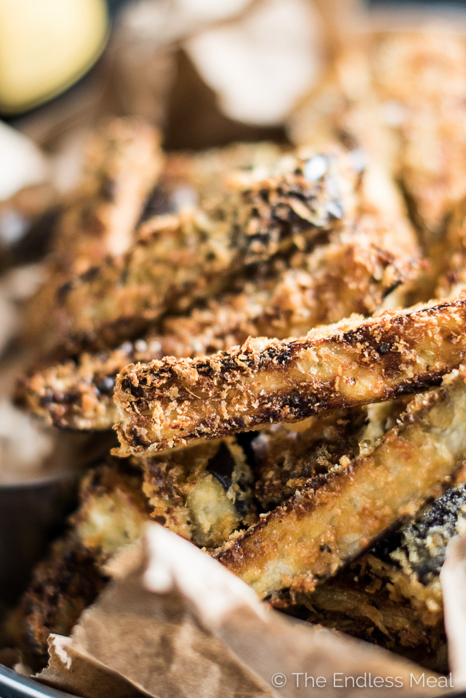 A closeup of super crispy baked eggplant fries.