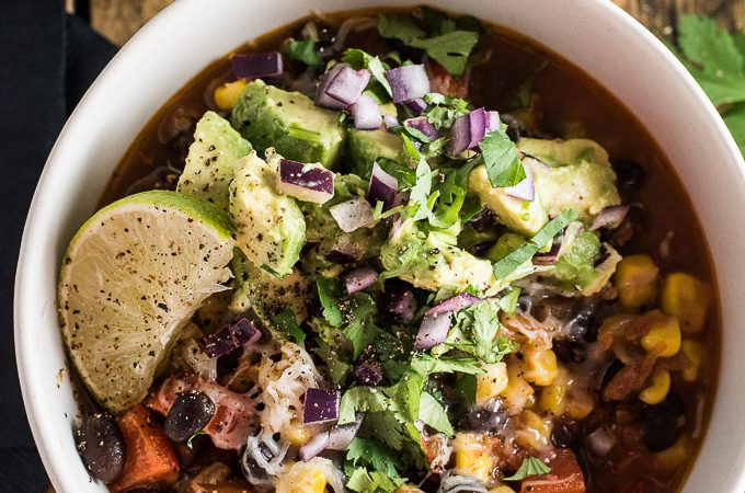 This vegetarian (and vegan!) Black Bean and Corn Chili is a healthy and delicious recipe that takes only 30 minutes to make. It's topped with a simple avocado salsa for the ultimate southwest chili recipe. | theendlessmeal.com