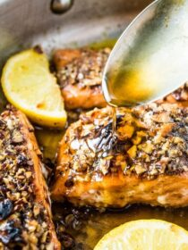 Pecan Crusted Salmon for the win! This super easy and healthy fish recipe will be a hit with everyone at your dinner table. The salmon is seasoned then coated in toasted pecans and cooked in a delicious maple glaze. You will love it! | gluten-free + paleo + dairy-free option | theendlessmeal.com | #salmon #fish #trout #pecans #pecansalmon #glutenfree #paleo #dairyfree #dinnerrecipes #healthydinners