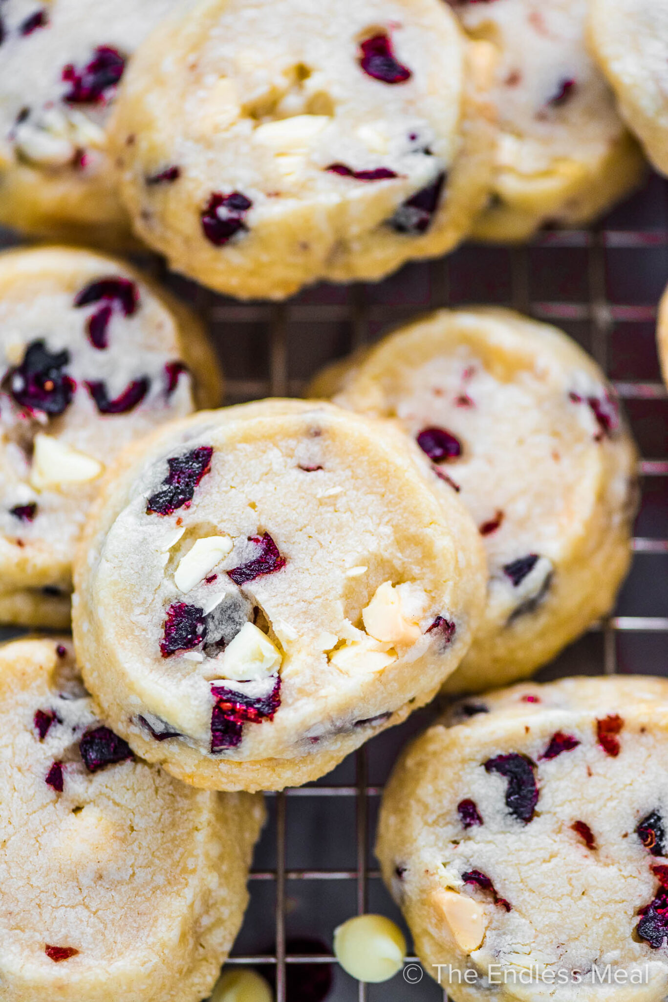 A closeup of a slice and bake white chocolate cranberry cookie.