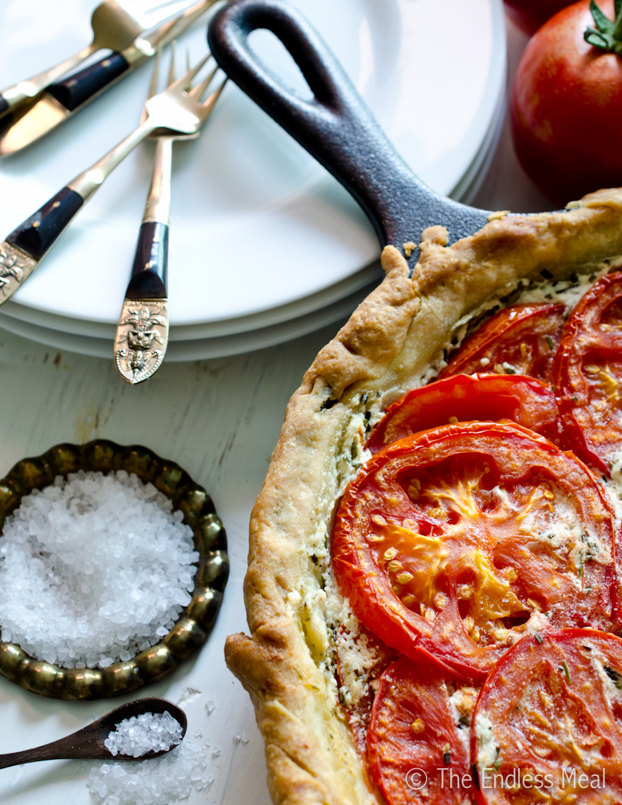 A close up of the flaky pie crust in the tomato tart.