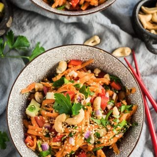 This super easy to make Asian Salad Recipe is packed full of healthy veggies and tossed in a tasty sesame salad dressing. It's fresh and crunchy and a crazy delicious side dish. It's also naturally vegan + paleo + gluten-free + Whole30 compliant. Win win! | theendlessmeal.com