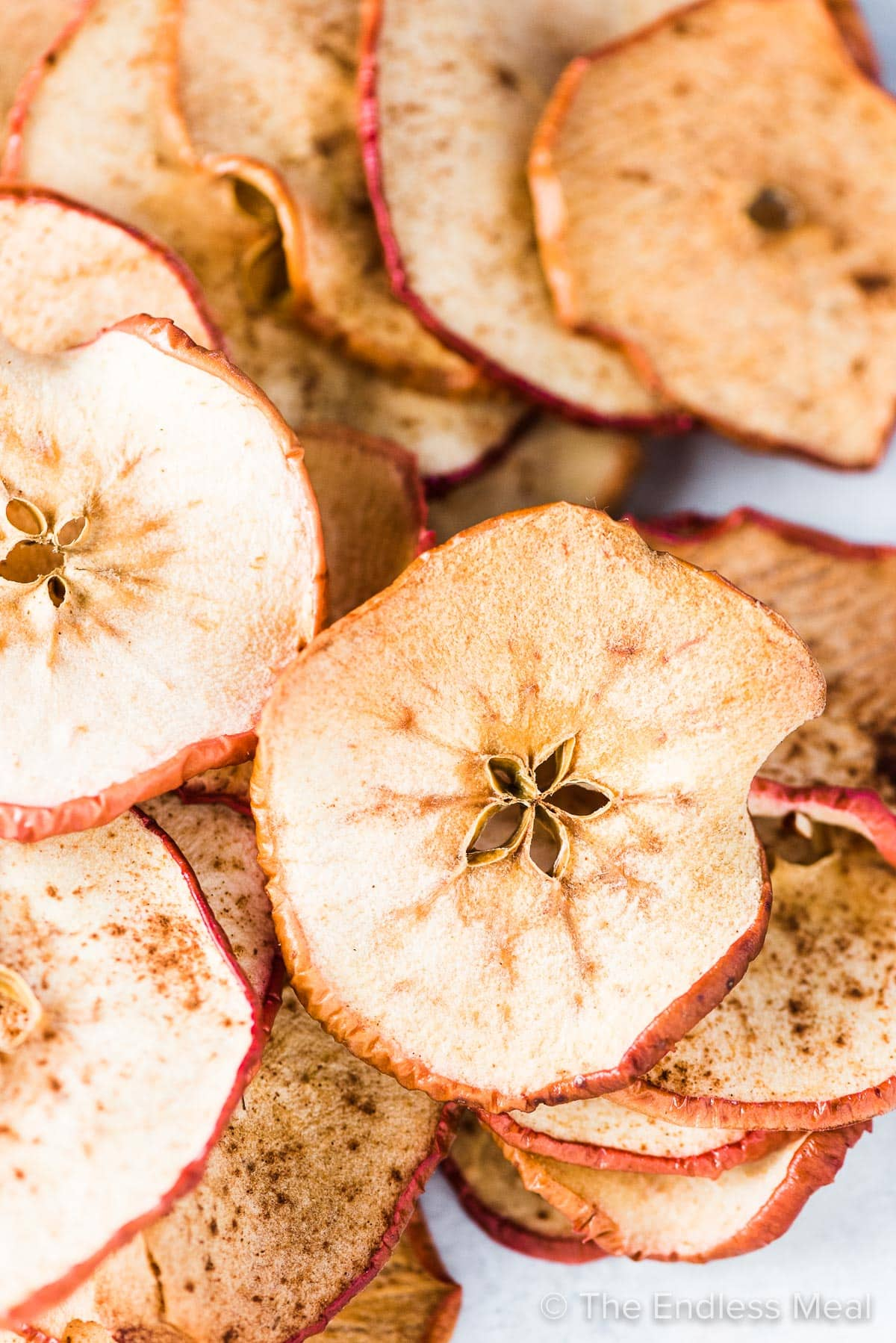 A big pile of baked apple chips.