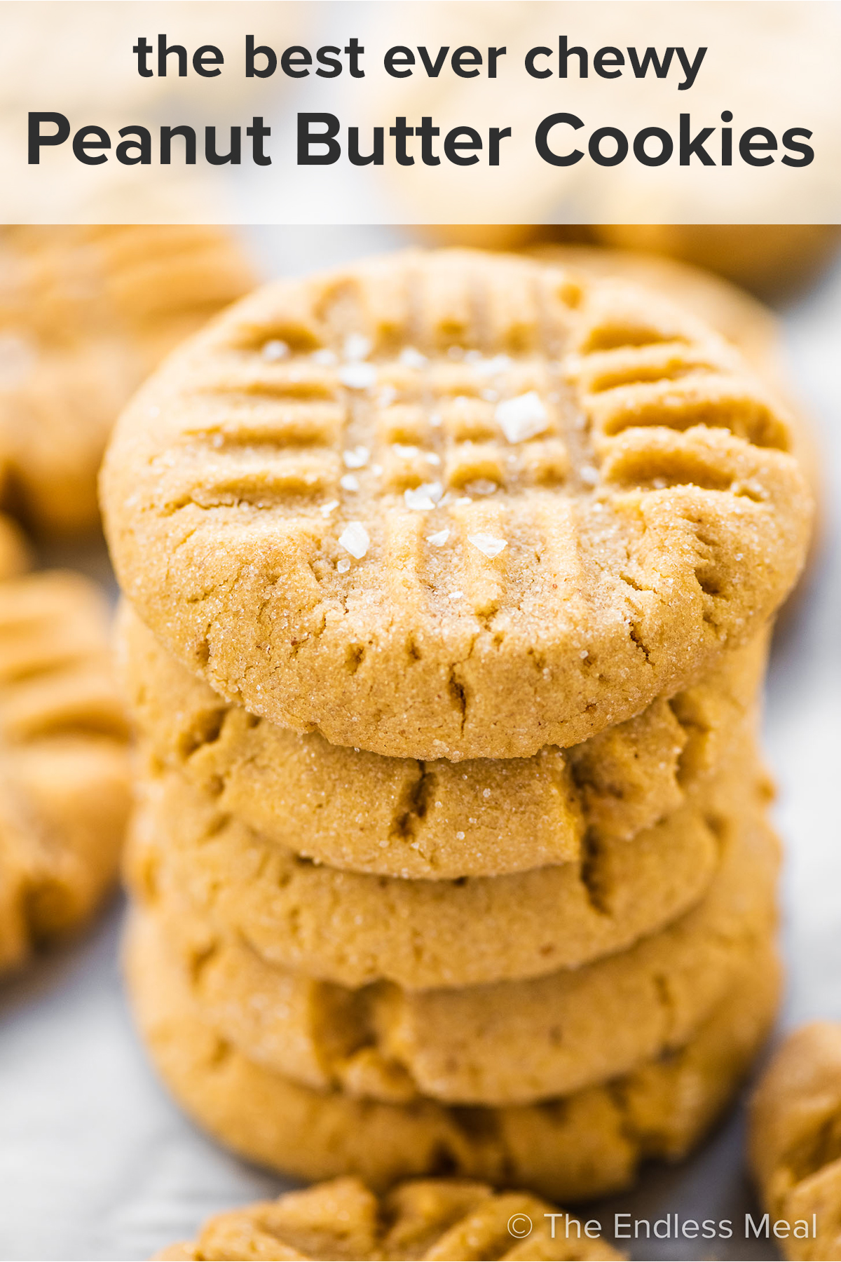 A stack of chewy peanut butter cookies with the recipe title on top of the picture.