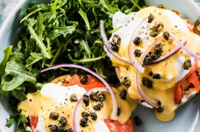 Smoked Salmon Eggs Benedict is the ultimate Sunday brunch recipe. It's healthy, delicious, and a real treat. Plus, with some make-ahead tips I have for you, it's a breeze to make for a group. You will LOVE it! | gluten-free + paleo and Whole30 adaptable | #theendlessmeal #mothersday #eggs #eggsbenedict #brunch #salmon #breakfast #paleo #whole30 #healthyrecipes