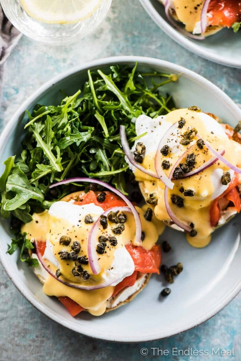 Smoked Salmon Eggs Benedict is the ultimate Sunday brunch recipe. It's healthy, delicious, and a real treat. Plus, with some make-ahead tips I have for you, it's a breeze to make for a group. You will LOVE it!   gluten-free + paleo and Whole30 adaptable   #theendlessmeal #mothersday #eggs #eggsbenedict #brunch #salmon #breakfast #paleo #whole30 #healthyrecipes