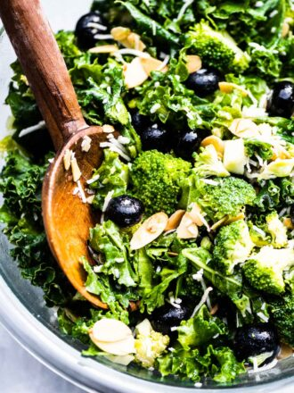 A close up of kale broccoli salad in a salad bowl.