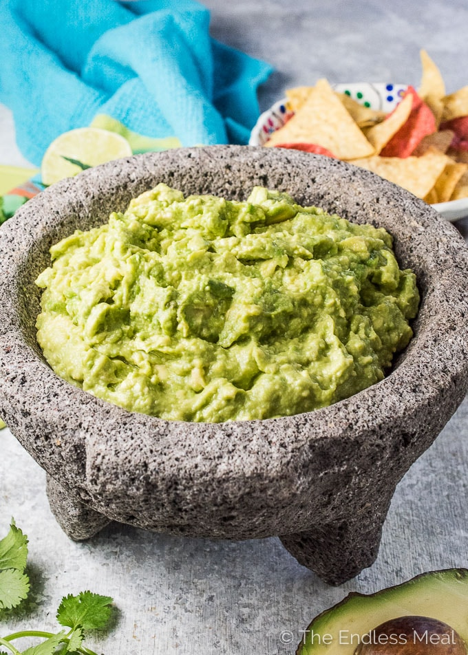 This quick and easy guacamole recipe will take you less than 5 minutes to make. It is super simple, healthy, and so delicious. I promise you that anyone can make this! | gluten-free + vegan + paleo + Whole30 approved | theendlessmeal.com | #guacamole #mexican #cincodemayo #vegan #glutenfree #paleo #whole30 #healthyrecipes #avocados