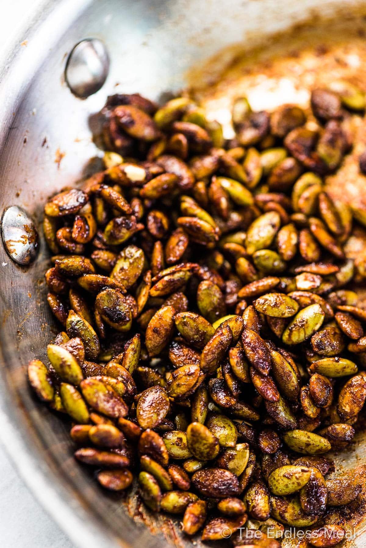 A frying pan filled with salty tamari pumpkin seeds.