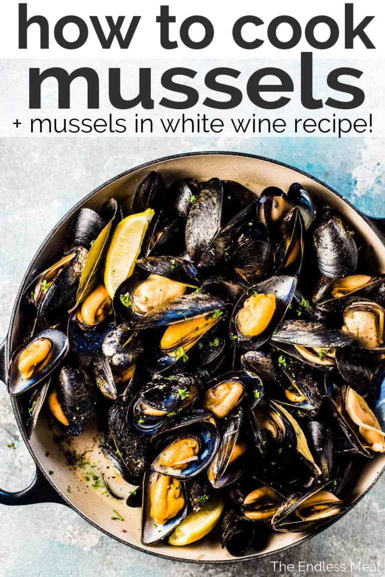 A Pinterest image with title and a big pot of mussels in white wine.