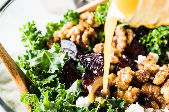 This healthy Roasted Beet and Kale Salad is ridiculously delicious. It's tossed in a maple balsamic dressing and dotted with roasted beets, maple candied walnuts, and goat cheese. When I make this for friends, they always ask for the recipe. You DEFINITELY want to make this one! | theendlessmeal.com
