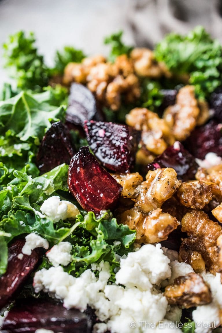 This healthy Roasted Beet and Kale Salad is ridiculously delicious. It's tossed in a maple balsamic dressing and dotted with roasted beets, maple candied walnuts, and goat cheese. When I make this for friends, they always ask for the recipe. You DEFINITELY want to make this one! | theendlessmeal.com | #beets #beetsalad #kale #kalesalad #healthyrecipes #salad #saladrecipes #healthy