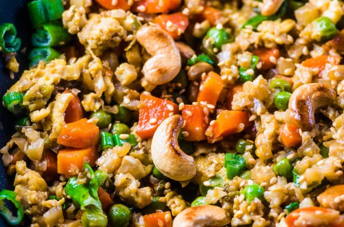 Looking down on a pan of cauliflower fried rice with cashews.