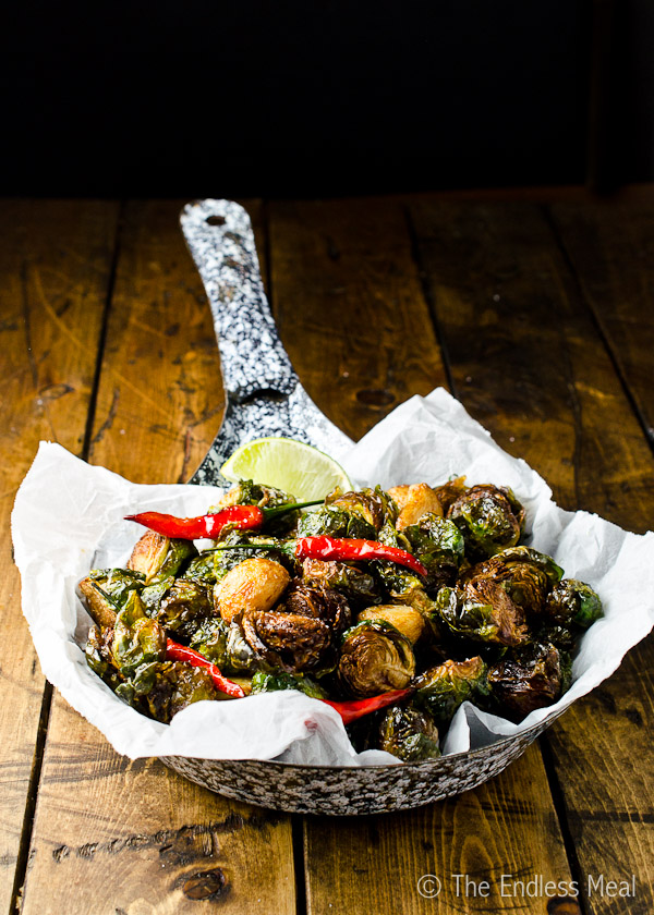 Coconut Oil Fried Brussels Sprouts with Garlic, Chilies and Lime
