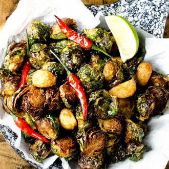 Coconut Oil Fried Brussels Sprouts w/ Garlic Chilies and Lime