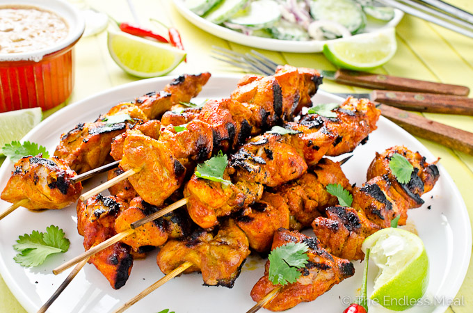These delicious Thai Chicken Kebabs are the perfect BBQ dinner recipe. They're served with a spicy satay sauce that can be made with either peanut butter or (for a paleo-friendly recipe) with almond butter and a cucumber salad to cool the heat. They're an easy and healthy summer recipe.| theendlessmeal.com