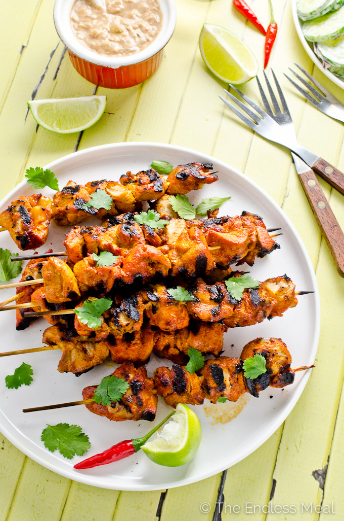 These delicious Thai Chicken Kebabs are the perfect BBQ dinner recipe. They're served with a spicy satay sauce that can be made with either peanut butter or (for a paleo-friendly recipe) with almond butter and a cucumber salad to cool the heat. They're an easy and healthy summer recipe. | theendlessmeal.com