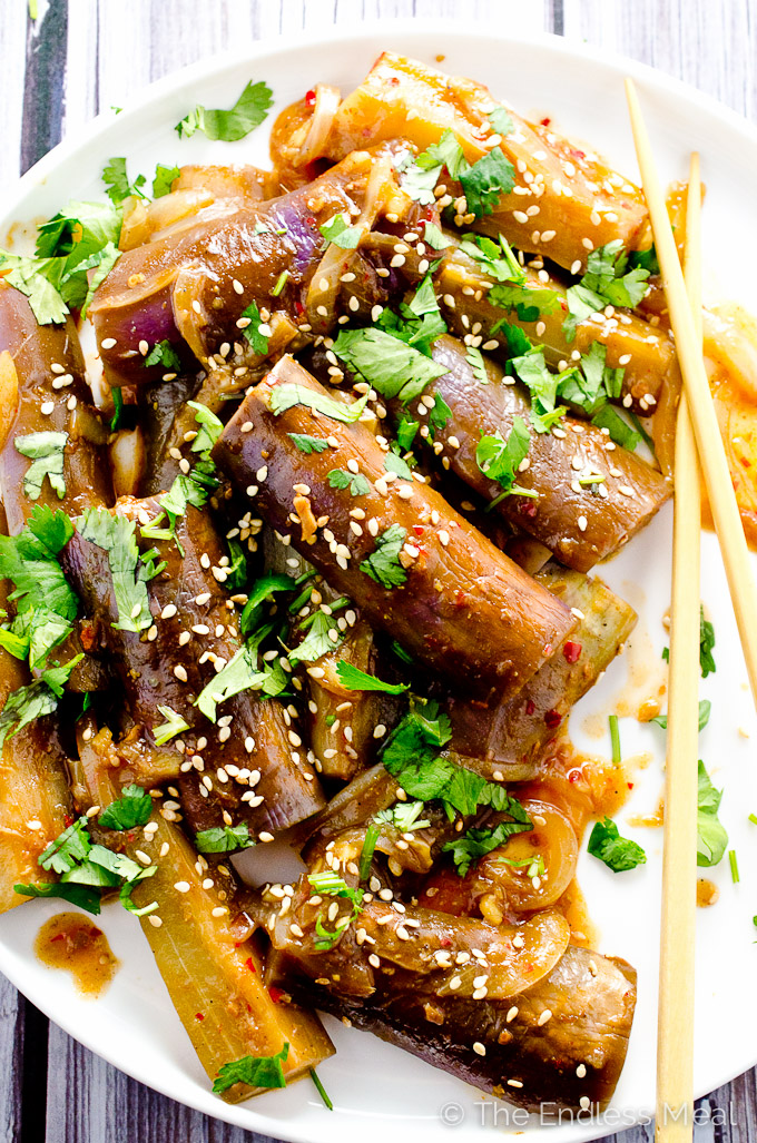 Sweet and Spicy Asian Eggplant on a white plate with chopsticks.