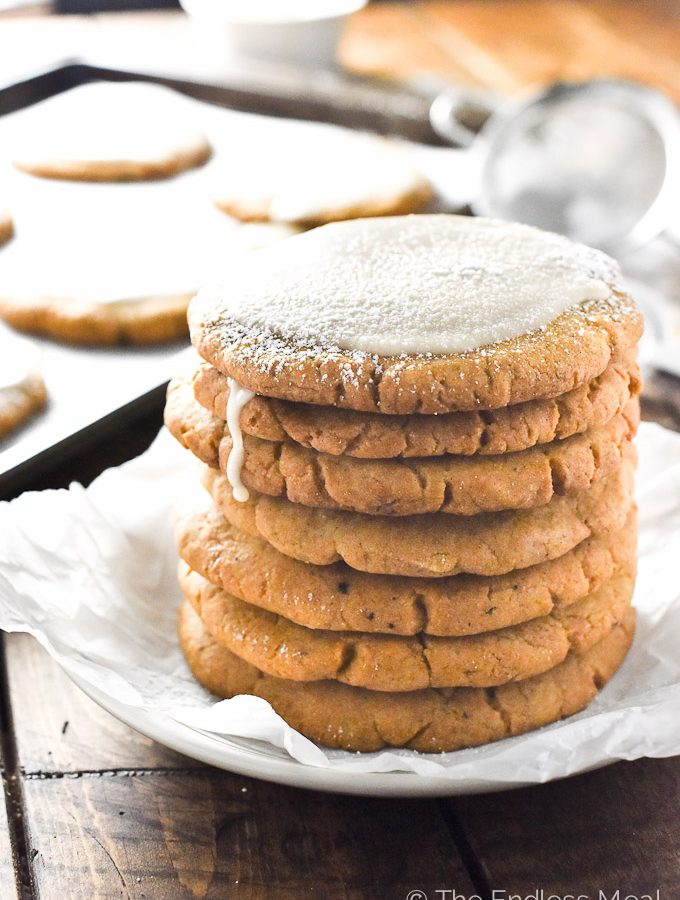 Crispy Pumpkin Sugar Cookies with Ginger Maple Glaze | theendlessmeal.com