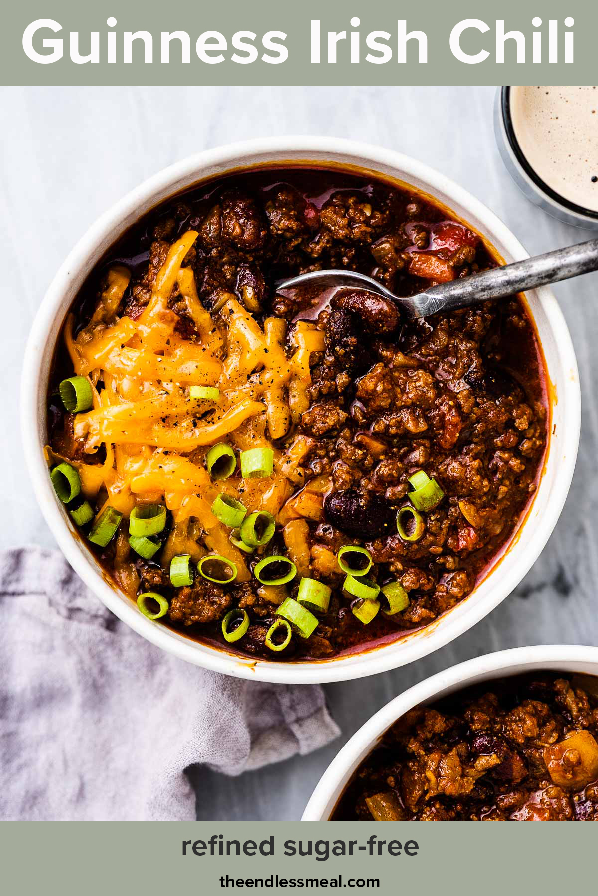 Two bowls of Irish chili with glasses of Guinness on the side with the recipe title on the top.