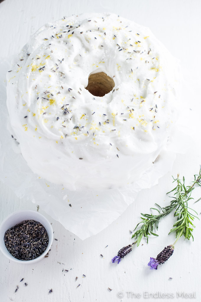 Lavender Lemon Angel Food Cake is light, fluffy and so delicious. It's covered in an easy to make meringue frosting and sprinkled with lemon zest and lavender flowers. It's a beautiful and surprisingly easy dessert to make.   theendlessmeal.com