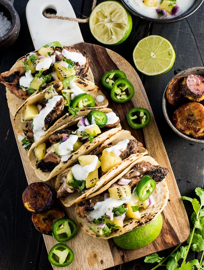 These healthy and delicious Grilled Jerk Chicken Tacos are topped with gold kiwifruit salsa and served with a side of sweet coconut plantations. Fire up your BBQ and get outside for dinner. | theendlessmeal.com