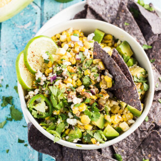 This Lightened Up Mexican Corn Dip recipe is big on flavor. Using Greek-style yogurt and avocado instead of mayo, this is as healthy as it is delicious. It makes a great side salad, too! | theendlessmeal.com
