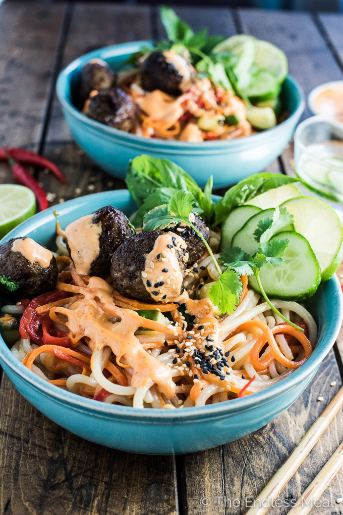 If you love banh mi sandwiches you will LOVE these healthy Banh Mi Noodle Bowls. They're made with rice noodles, crispy veggies and a light and tangy ginger-lime dressing. On top sit tender and flavorful lemongrass Vietnamese meatballs and a drizzle of creamy Sriracha mayo. This is the kind of easy dinner recipe you'll want to eat all summer long! | theendlessmeal.com