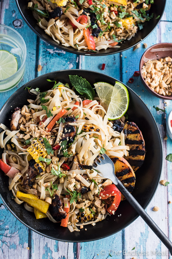 Once you try Grilled Chicken Pad Thai there is no going back. The flavors are light and summery with sweet grilled peaches and corn, fresh mint and basil and a bright pop of lime. It's delicious hot or cold as a healthy summer main course or a BBQ or picnic side. | theendlessmeal.com