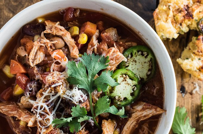 This Crock Pot Chicken Chili recipe is smoky, a touch sweet, and totally delicious. It is flavoured with bourbon and BBQ sauce and slow cooked until the chicken is fall-apart tender. You will LOVE this easy to make, slow cooker dinner recipe! theendlessmeal.com