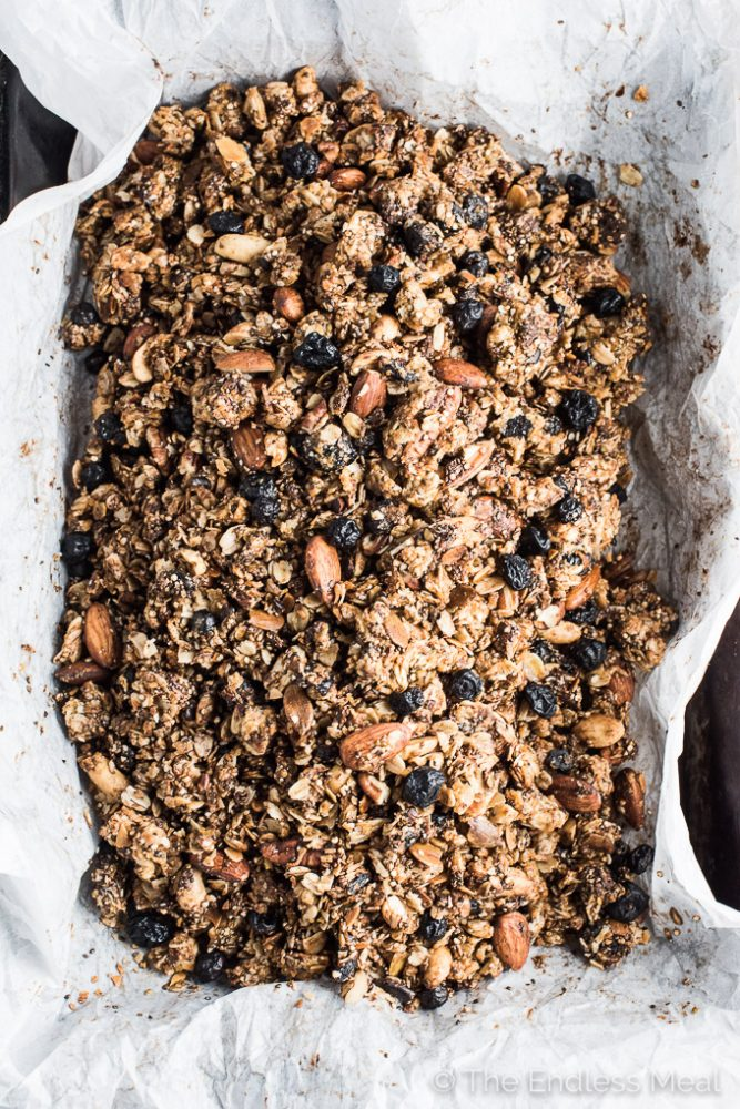 This easy to make and crazy delicious Superfood Granola recipe is packed full of breakfast power foods. Big chunks of crunchy granola, lots of nuts, coconut and blueberries will help you start your morning the right way. | theendlessmeal.com