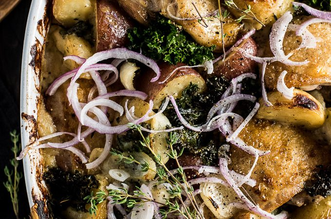 Healthy One Pan Chicken Potato Gratin is a remake of the famous classic. We've snuck in extra veggies by replacing the traditional butter and flour heavy sauce for a rich and cheesy cauliflower sauce, then nestled in some crispy skinned chicken and kale for a delicious and easy to make dinner recipe. | theendlessmeal.com