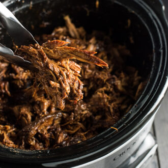 Crock Pot Korean Gochujang Pork is crazy tender and slightly sweet, smoky, and a little spicy. It's a super easy dinner recipe that can be served as a main, or on pizza, noodles, tacos, and more. You will LOVE it! | theendlessmeal.com