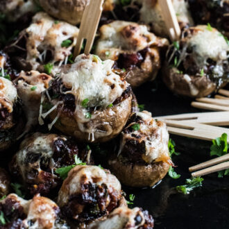 Chorizo Stuffed Mushroom Caps are topped with cheese and baked till melty and delicious. They're easy to make ahead and a crazy delicious appetizer recipe for any party.   theendlessmeal.com