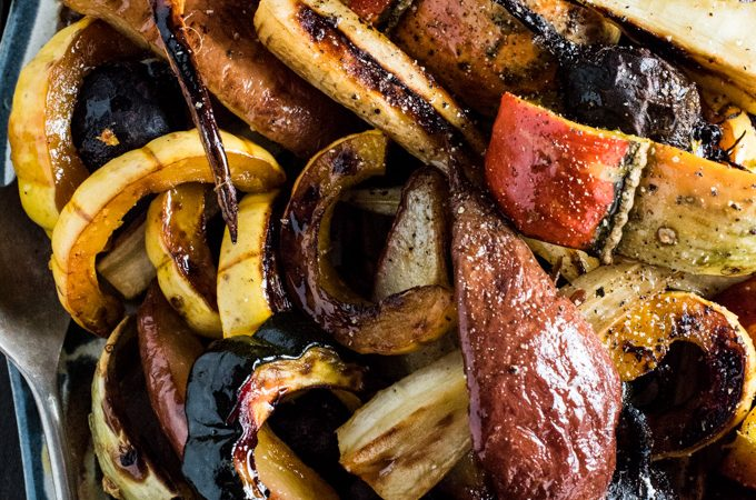 These delicious Roasted Root Vegetables and Pears are drizzled in a sweet and savory maple vanilla butter. They make an easy and beautiful side dish for any winter holiday meal. | theendlessmeal.com