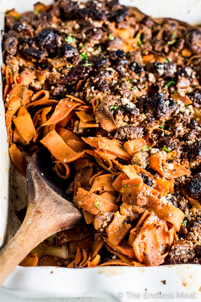 Sweet Potato Ribbon Casserole is made with pre-cut sweet potato ribbons that are coated in a maple, bourbon glaze and topped with sweet and crunchy pecans. It's a simple to make and beautiful Christmas side dish recipe that is naturally vegan, paleo, and gluten-free. | theendlessmeal.com | #thanksgiving #thanksgivingrecipe #healthyrecipes #healthycasserole #sweetpotato #christmas #christmasrecipes #paleo #paleorecipes