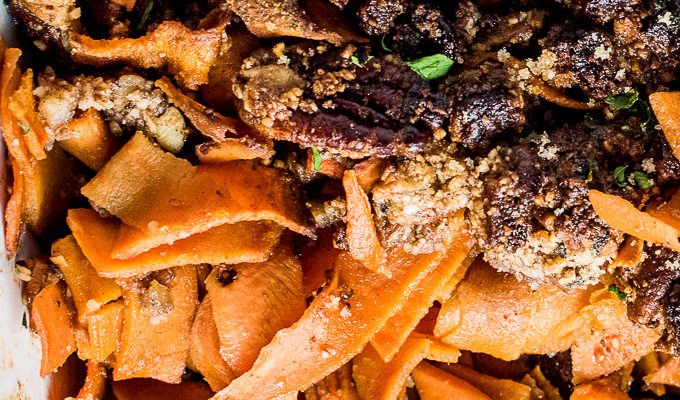 Sweet Potato Ribbon Casserole is made with pre-cut sweet potato ribbons that are coated in a maple, bourbon glaze and topped with sweet and crunchy pecans. It's a simple to make and beautiful Christmas side dish recipe that is naturally vegan, paleo, and gluten-free. | theendlessmeal.com