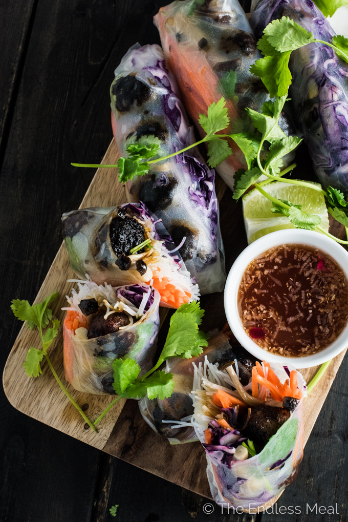 These Banh Mi Winter Rolls are my take on a healthy banh mi alternative. They're made like a traditional Vietnamese summer roll and stuffed with mini lemongrass meatballs, rice vermicelli, and a few vegetables. They're served with a spicy vinegar dipping sauce and are so delicious. | theendlessmeal.com