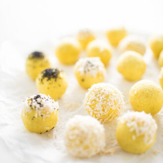 These Coconut Lemon Energy Balls are made with raw cashews, coconut, and lemon juice and zest. They're brightly flavored and a delicious pick-me-up, healthy snack recipe.   theendlessmeal.com